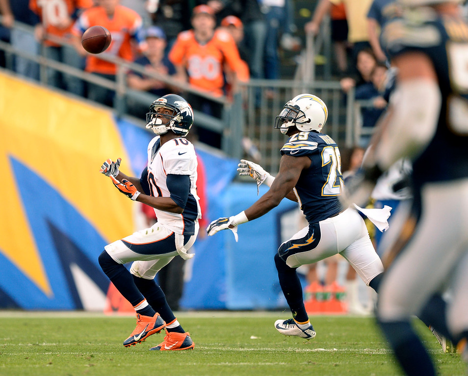 . SAN DIEGO, CA - DECEMBER 14: Denver Broncos wide receiver Emmanuel Sanders (10) looks up to make a catch on San Diego Chargers cornerback Shareece Wright (29) during the fourth quarter  December 14, 2014 at Qualcomm Stadium (Photo By John Leyba/The Denver Post)