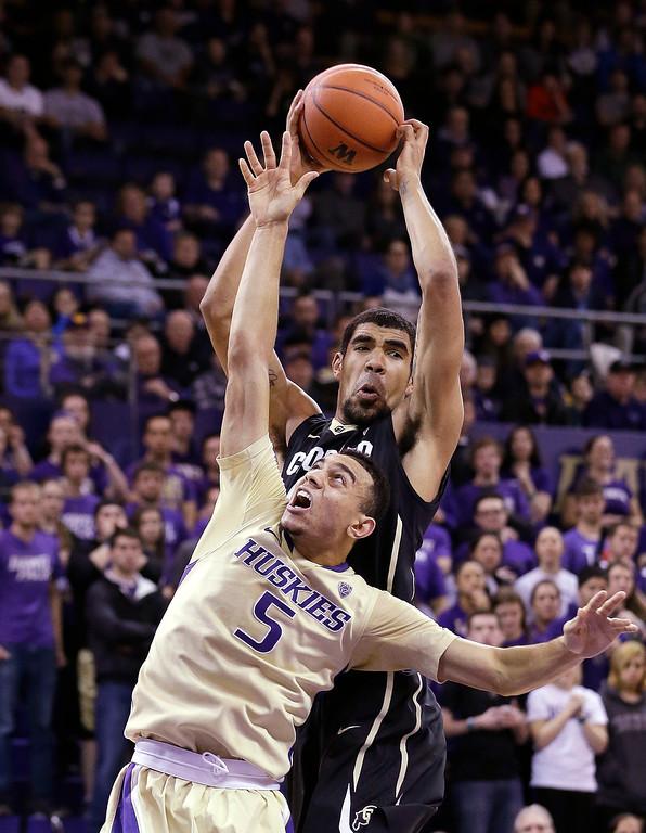 . Washington\'s Nigel Williams-Goss (5) falls short of a rebound to Colorado\'s Josh Scott in the first half of an NCAA men\'s basketball game Sunday, Jan. 12, 2014, in Seattle. (AP Photo/Elaine Thompson)