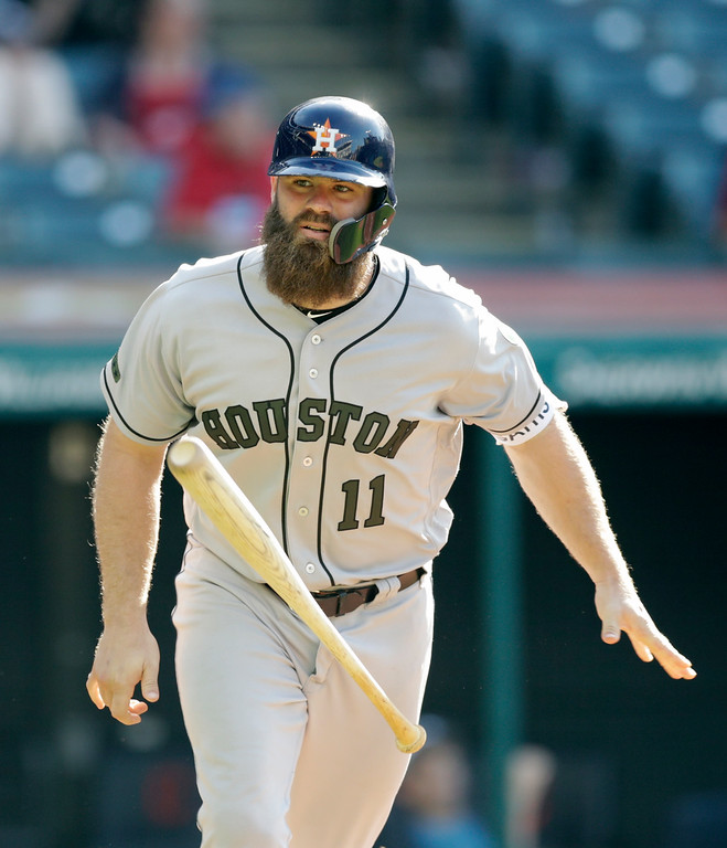 . Houston Astros\' Evan Gattis tosses his bat after hitting a solo home run off Cleveland Indians relief pitcher Dan Otero in the 13th inning of a baseball game, Sunday, May 27, 2018, in Cleveland. (AP Photo/Tony Dejak)
