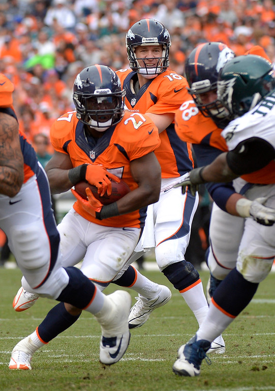 . Denver Broncos running back Knowshon Moreno (27) runs the ball under the watchful eye of quarterback Peyton Manning (18) during the third quarter. (Photo by Joe Amon/The Denver Post)