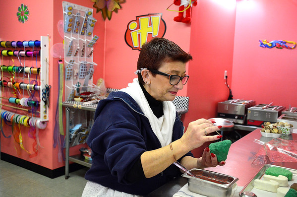 11/24/2018 Mike Orazzi | Staff Karen Masi works on holiday items at It Candy in the Forestville section of Bristol on Saturday.