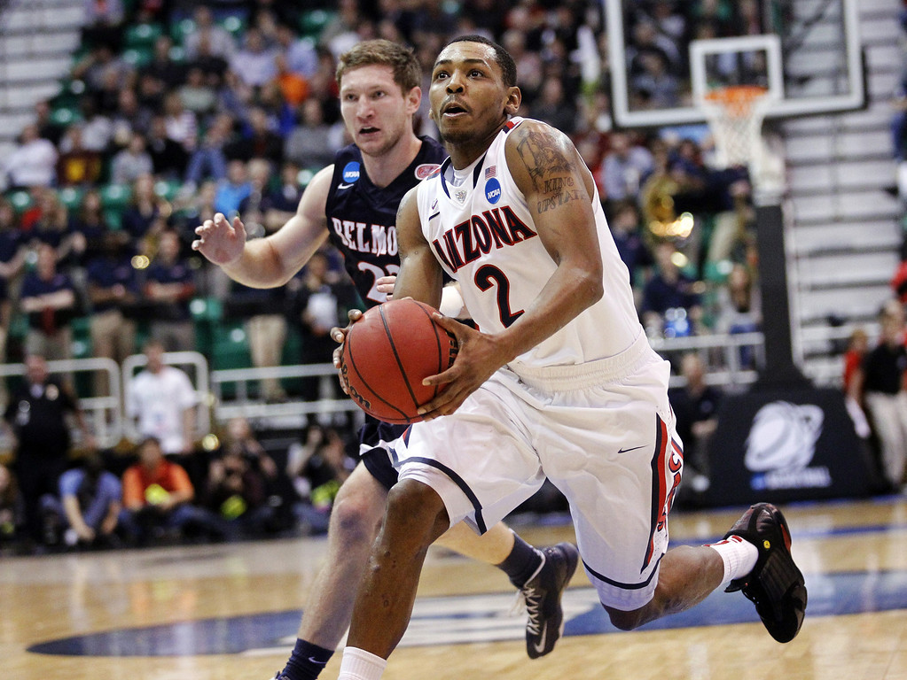 . Arizona\'s Mark Lyons (2) drives to the basket past Belmont\'s Reece Chamberlain (22) in the second half during a second-round game in the NCAA college basketball tournament in Salt Lake City, Thursday, March 21, 2013. Arizona won 81-64. (AP Photo/Rick Bowmer)