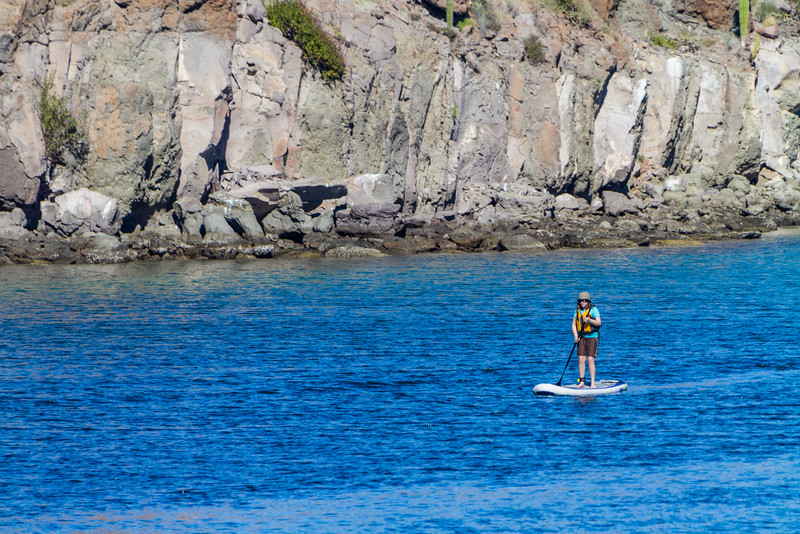 Woman doing stand up paddleboarding in sea - Mexico