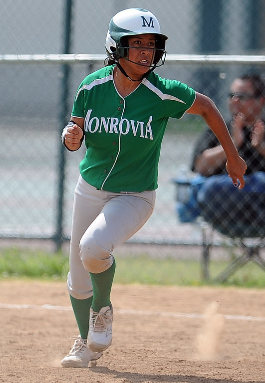. Monrovia\'s Galvan Tanya bases loaded double as three runs score in the fifth inning of the Northview Tournament championship softball game against Covina at Northview High School on Thursday, April 4, 2013 in Covina, Calif.  Monrovia won 6-0. 