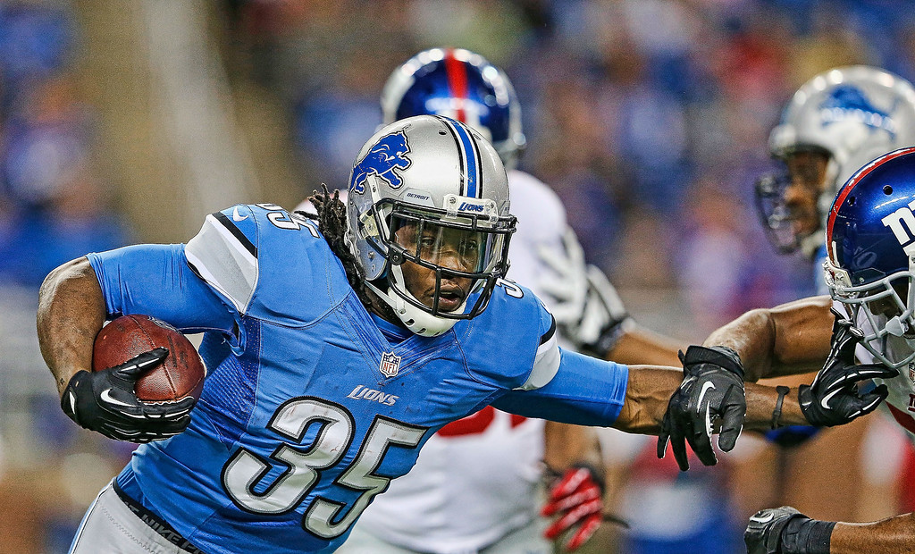 . Joique Bell #35 of the Detroit Lions runs for a short gain during the second quarter of the game against the New York Giants at Ford Field on December 22, 2013 in Detroit, Michigan.  (Photo by Leon Halip/Getty Images)