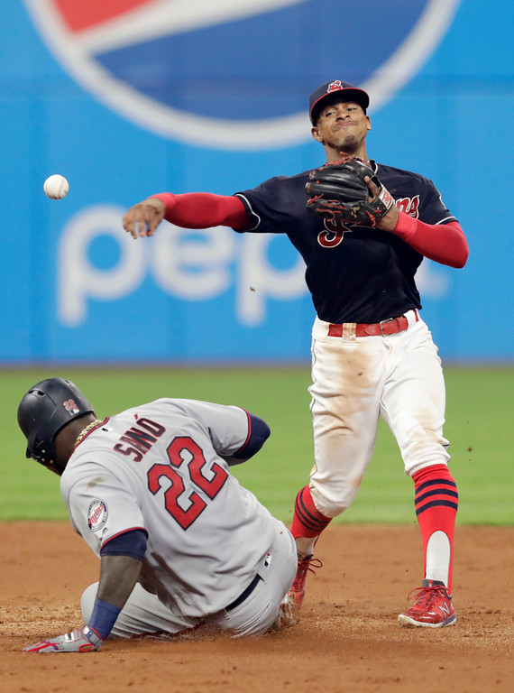 . Cleveland Indians\' Francisco Lindor gets Minnesota Twins\' Miguel Sano out at second base in the sixth inning of a baseball game, Tuesday, Aug. 28, 2018, in Cleveland. Max Kepler was safe at first base. (AP Photo/Tony Dejak)