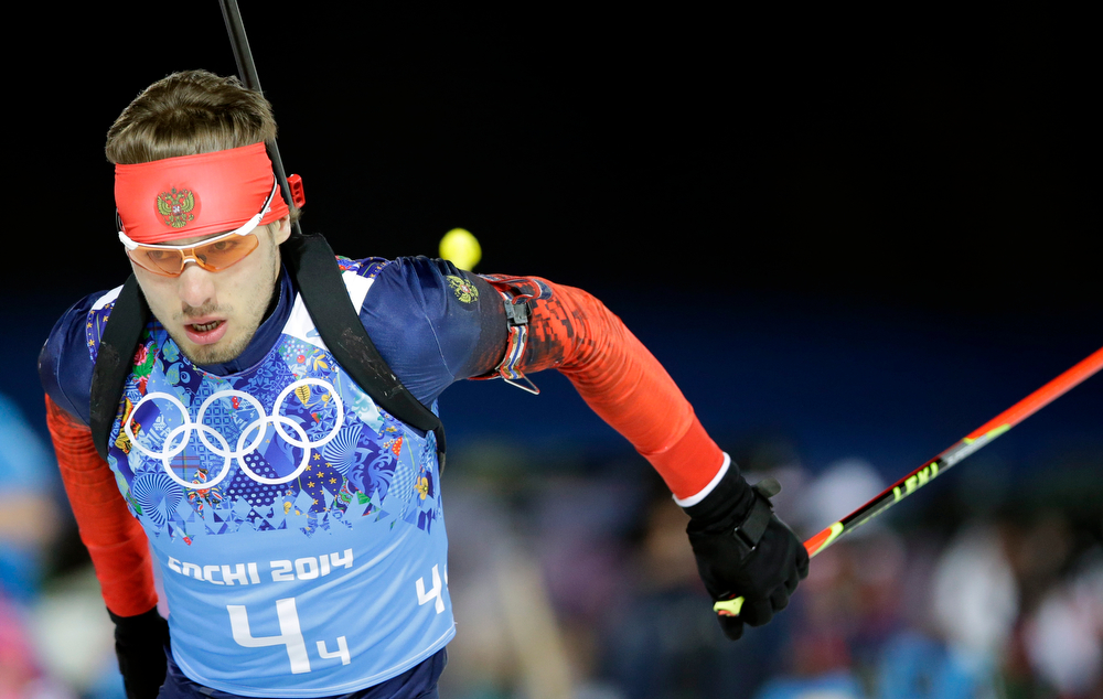 . Russia\'s Anton Shipulin competes on his way to win the gold in the men\'s biathlon 4x7.5K relay at the 2014 Winter Olympics, Saturday, Feb. 22, 2014, in Krasnaya Polyana, Russia. (AP Photo/Lee Jin-man)