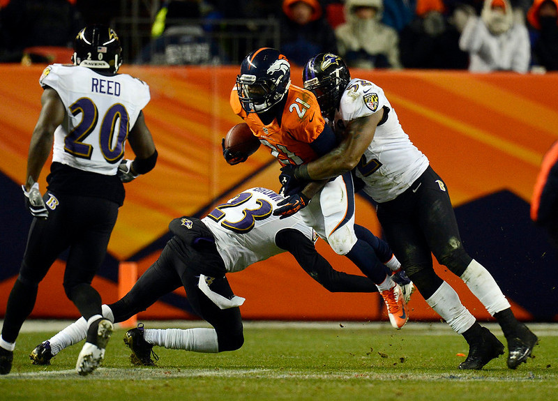 . Denver Broncos running back Ronnie Hillman (21) gets hit from behind and taken down by Baltimore Ravens inside linebacker Ray Lewis (52) and Baltimore Ravens defensive back Chykie Brown (23) during the second half.  The Denver Broncos vs Baltimore Ravens AFC Divisional playoff game at Sports Authority Field Saturday January 12, 2013. (Photo by Joe Amon,/The Denver Post)