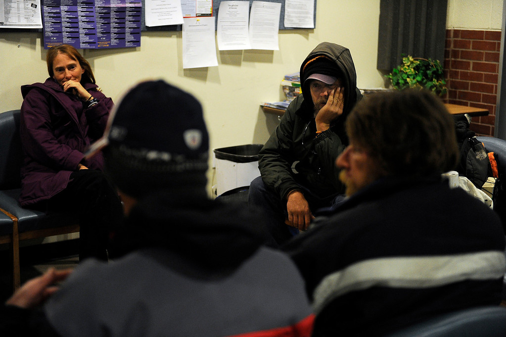 . WESTMINSTER, CO - JANUARY 22: A group of homeless individuals wait for a bus in the lobby of the Jefferson County Action Center in Lakewood, Colorado to transport them to a local church to stay the night on January 22, 2014. The Jefferson County Action Center began partnering with churches last year to offer emergency shelter for the homeless on severe weather nights. (Photo by Seth McConnell/The Denver Post)