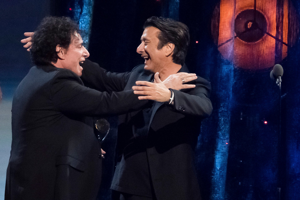. Inductees Neal Schon, left, and Steve Perry from the band Journey embrace at the 2017 Rock and Roll Hall of Fame induction ceremony at the Barclays Center on Friday, April 7, 2017, in New York. (Photo by Charles Sykes/Invision/AP)