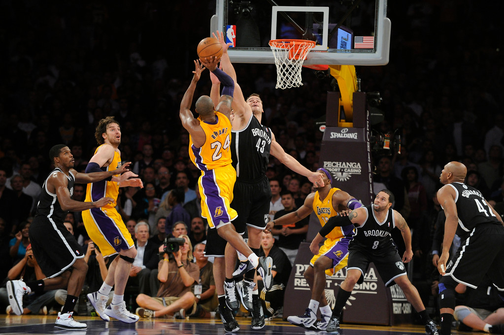 . Kobe Bryant gets a shot off in the final minutes of the 4th quarter. Lakers new coach Mike D\'Antoni shows some fire from the bench. The Lakers defeated the Brooklyn Nets 95-90 in a game played at Staples Center in Los Angeles, CA. The game was new coach Mike D\'Antoni\'s first victory as a Laker. 11/20/12 (photos by John McCoy/Staff Photographer)