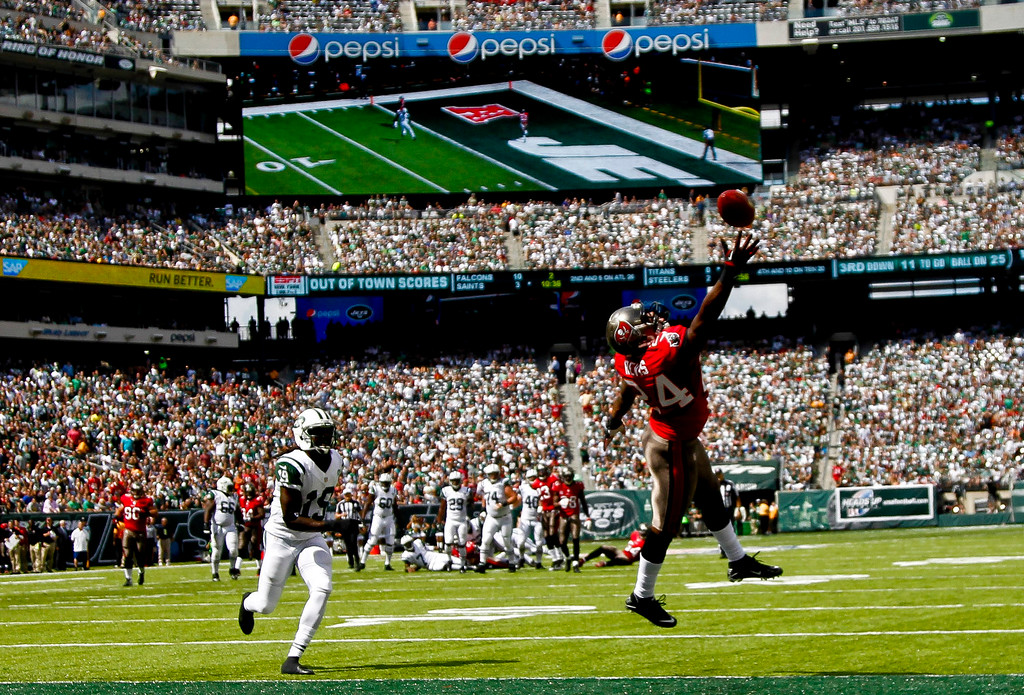 . Darrelle Revis #24 of the Tampa Bay Buccaneers leaps for a pass intended for Clyde Gates #19 of the New York Jets during their game at MetLife Stadium on September 8, 2013 in East Rutherford, New Jersey.  (Photo by Jeff Zelevansky/Getty Images)