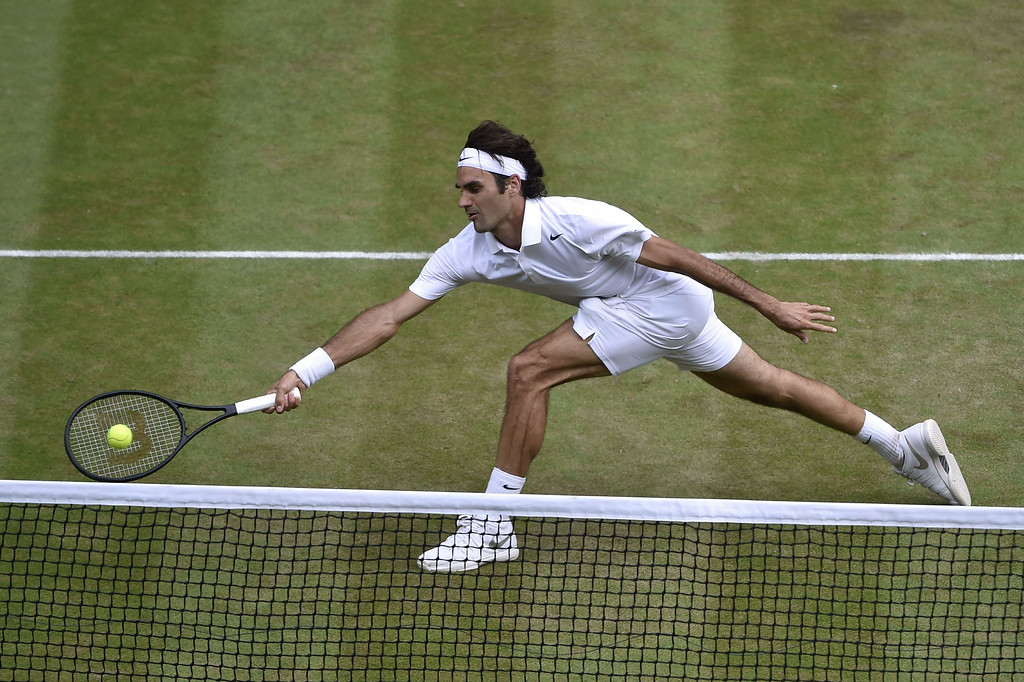 . Switzerland\'s Roger Federer returns to Serbia\'s Novak Djokovic during their men\'s singles final match on day thirteen of the 2014 Wimbledon Championships at The All England Tennis Club in Wimbledon, southwest London, on July 6, 2014.   TOBY MELVILLE/AFP/Getty Images
