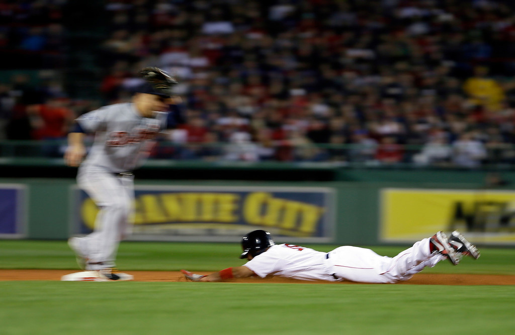 . Boston Red Sox\'s Shane Victorino, right, steals second as Detroit Tigers second baseman Omar Infante, left, takes the throw  during Game 1 of the American League baseball championship series Saturday, Oct. 12, 2013, in Boston. (AP Photo/Matt Slocum)