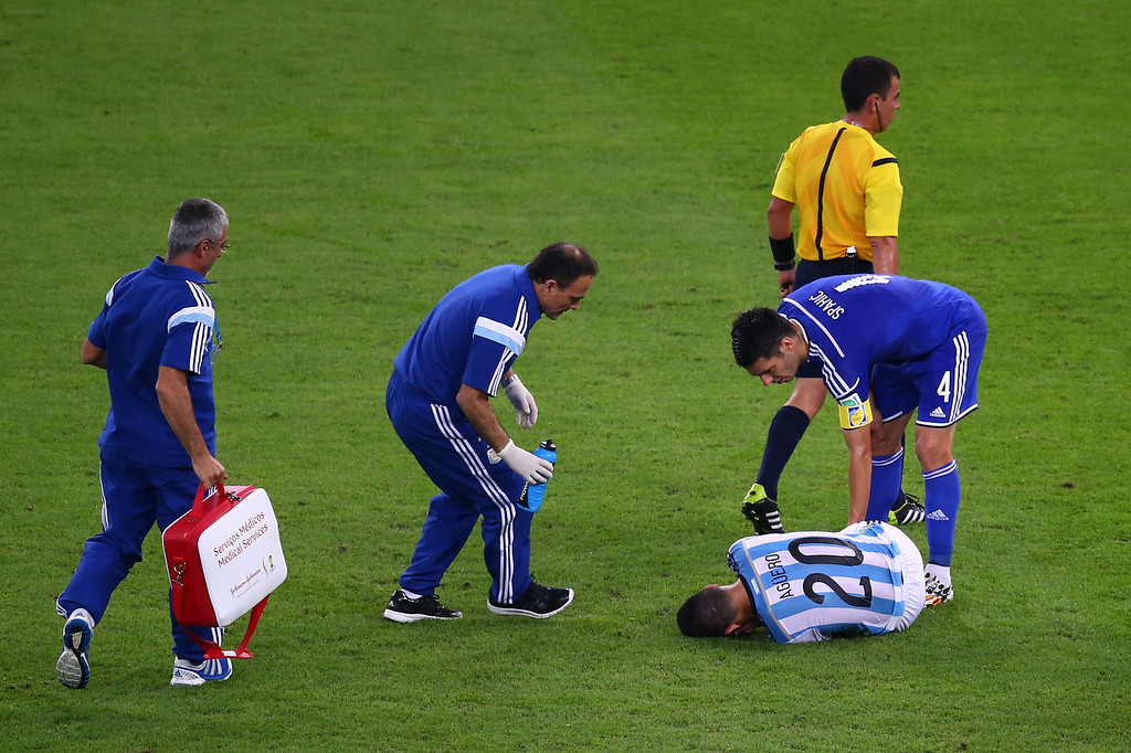 . Sergio Aguero of Argentina lies injured during the 2014 FIFA World Cup Brazil Group F match between Argentina and Bosnia-Herzegovina at Maracana on June 15, 2014 in Rio de Janeiro, Brazil.  (Photo by Clive Rose/Getty Images)
