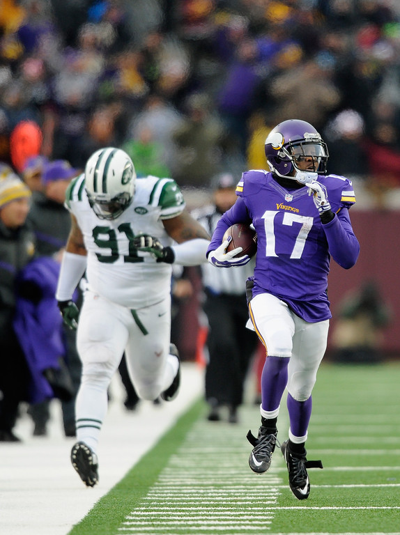 . MINNEAPOLIS, MN - DECEMBER 7: Jarius Wright #17 of the Minnesota Vikings carries the ball for a touchdown as Sheldon Richardson #91 gives chase during overtime of the New York Jets  of the game on December 7, 2014 at TCF Bank Stadium in Minneapolis, Minnesota. The Vikings defeated the Jets 30-24. (Photo by Hannah Foslien/Getty Images)