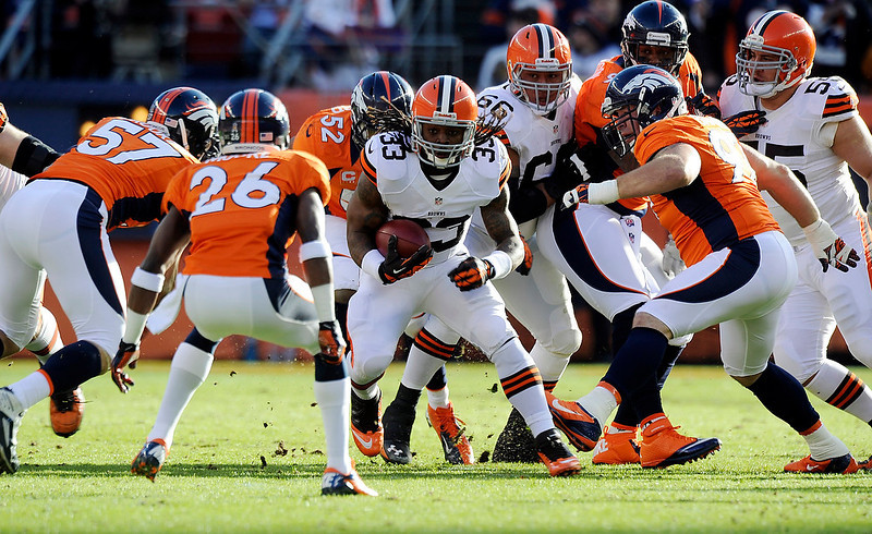. Cleveland Browns running back Trent Richardson (33) runs the ball during the first half.  The Denver Broncos vs Cleveland Browns at Sports Authority Field Sunday December 23, 2012. Tim Rasmussen, The Denver Post