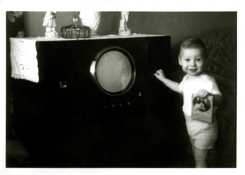 1950. Can I really be this old? Old enough to have watched a round screen TV? And it sure looks like I'm offering a visual rhyme between the book and the new technology...