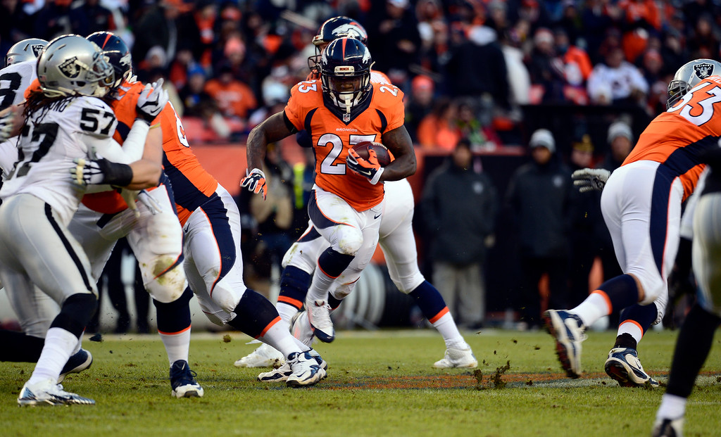 . DENVER, CO - DECEMBER 28: Ronnie Hillman (23) of the Denver Broncos carries the ball down the field through traffic during the third quarter.  The Denver Broncos played the Oakland Raiders at Sports Authority Field at Mile High in Denver on December, 28 2014. (Photo by Tim Rasmussen/The Denver Post)