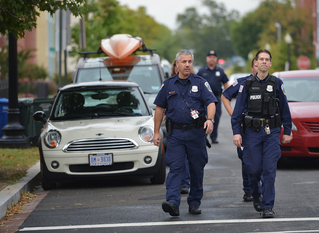 """. Police walk on a residential street near the Washington Navy Yard on September 16, 2013 in Washington, DC. One gunman has been killed and up to two more may still be at large after a shooting rampage at the US Naval base in Washington on Monday that left \""""multiple victims\"""" dead, the city\'s police chief said. \""""We have one shooter that we believe involved in this that is deceased,\"""" said Washington police chief Cathy Lanier. \""""The big concern for us right now is that we potentially have two other shooters that we have not located at this point.\""""   MANDEL NGAN/AFP/Getty Images"""