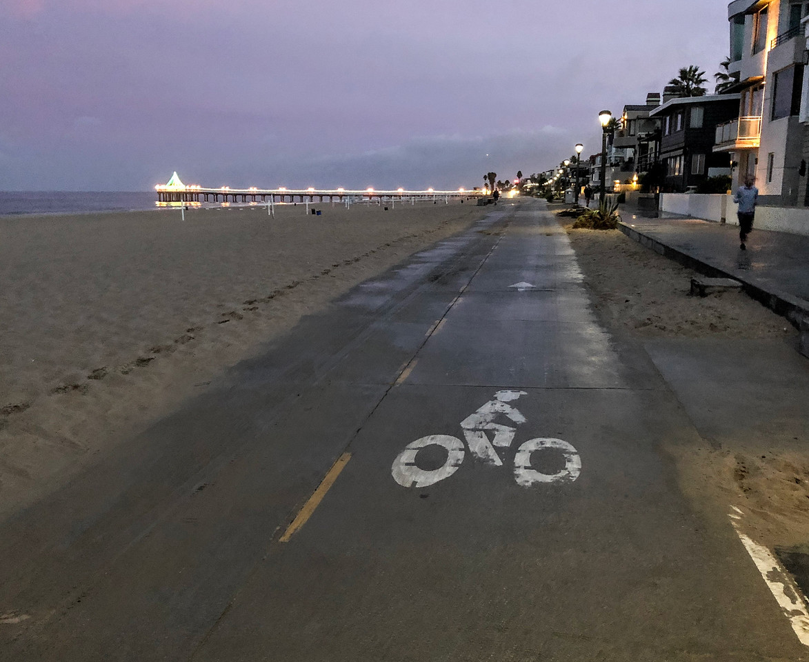 The bicycle lane of the Strand at Christmastime, early morning, before the cyclists have come out. The Marvin Braude bike trail extends all the way from Torrance Beach to the south all the way north to Pacific Palisades.