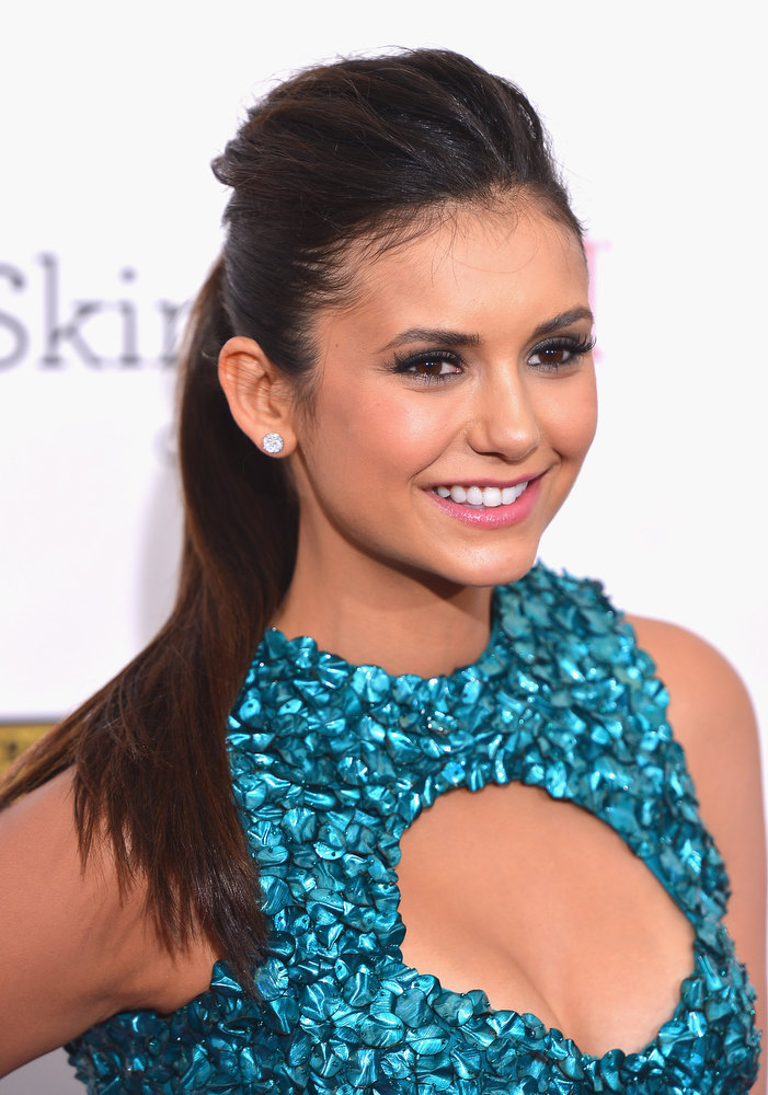 . Actress Nina Dobrev arrives at the 18th Annual Critics\' Choice Movie Awards at Barker Hangar on January 10, 2013 in Santa Monica, California.  (Photo by Frazer Harrison/Getty Images)