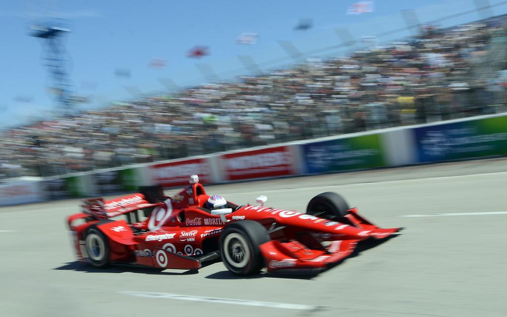 . Scott Dixon streaks down Shoreline Drive Sunday. Scott Dixon (9) wins the Toyota Grand Prix of Long Beach Sunday April 19, 2015.  (Will Lester/Staff Photographer)