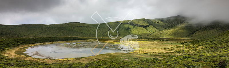 Landscape panorama at Lagoa Branca caldera crater lake on the Azores island of Ilha das Flores