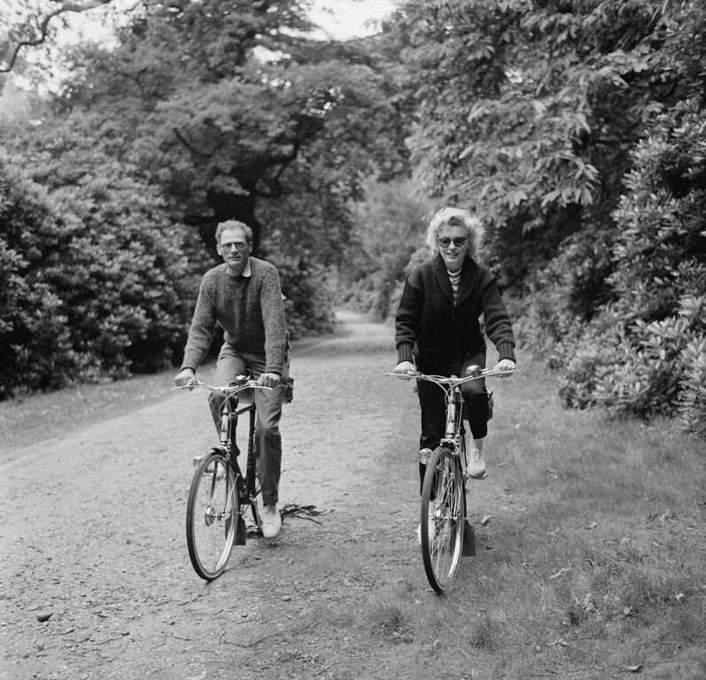 . American actress Marilyn Monroe (1926 - 1962) out for a cycle ride with her third husband, American dramatist Arthur Miller (1915 - 1905), 13th August 1956. (Photo by Harold Clements/Daily Express/Hulton Archive/Getty Images)