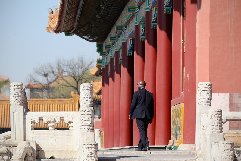 . U.S. security officer prepares for First Lady Michelle Obama\'s visit to the Forbidden City on March 21, 2014 in Beijing, China. Michelle Obama\'s one-week-long visit in China will be focused on educational and cultural exchanges.  (Photo by Feng Li/Getty Images)