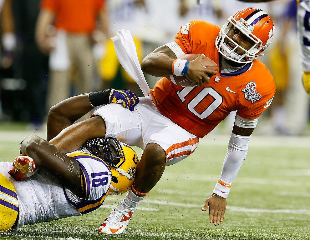 . Bennie Logan #18 of the LSU Tigers tackles Tajh Boyd #10 of the Clemson Tigers during the 2012 Chick-fil-A Bowl at Georgia Dome on December 31, 2012 in Atlanta, Georgia.  (Photo by Kevin C. Cox/Getty Images)