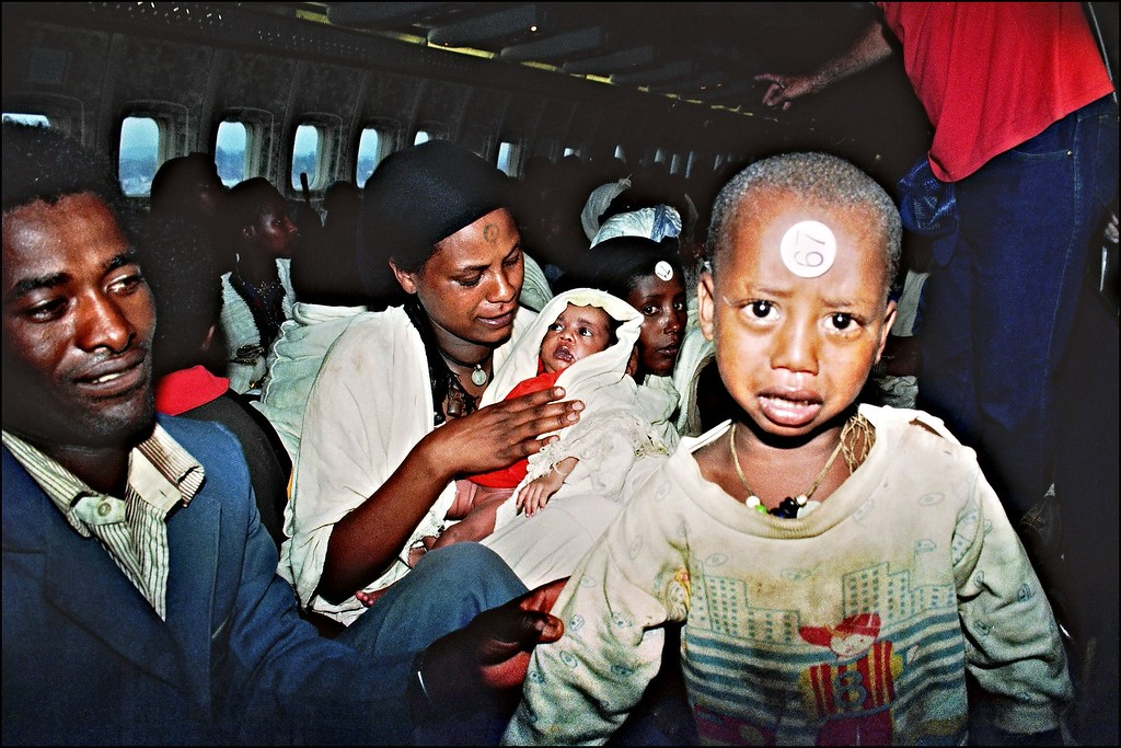 """. ON BOARD OF ISRAELI PLANE:Ethiopian Jews known as \""""Falashas\"""" sit on bard of an Israeli Air Force Boeing 707, during their transfer from Addis Ababa to Tel Aviv early 25 May 1991. Sixteen thousand five hundred \""""Falashas\"""" were evacuated from Ethiopia as part of \""""Operation Solomon\"""", the world\'s largest airlift carried out out by Israeli army. The large numbers of emigrants from Ethiopia and, primarily, from the Soviet Union, increased Israel\'s population by nearly 10 % in 3 years (between 1989-92). PATRICK BAZ/AFP/Getty Images"""