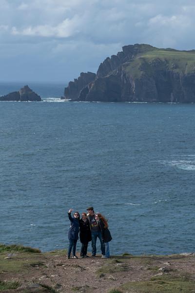 Family taking selfie on the coast, Ballyferriter, County Kerry, Ireland