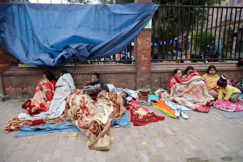 . Nepalese residents rest as they gather on a pavement in Kathmandu on April 26, 2015, a day after an earthquake hit. Rescuers in Nepal searched frantically for survivors of a quake that killed more than 2,000, digging through rubble in the devastated capital Kathmandu and airlifting victims of an avalanche at Everest base camp. PRAKASH MATHEMA/AFP/Getty Images