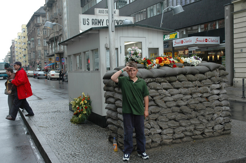 Henry in front of Checkpoint Charlie