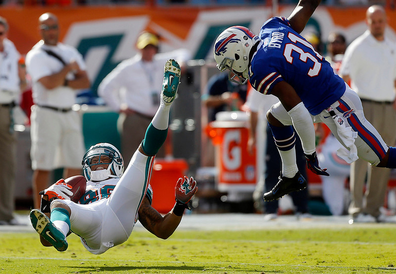 . Miami Dolphins wide receiver Rishard Matthews (86) is knocked to the ground by Buffalo Bills free safety Jairus Byrd (31) after making a catch in the first half of an NFL football game on Sunday, Dec. 23, 2012, in Miami. (AP Photo/John Bazemore)