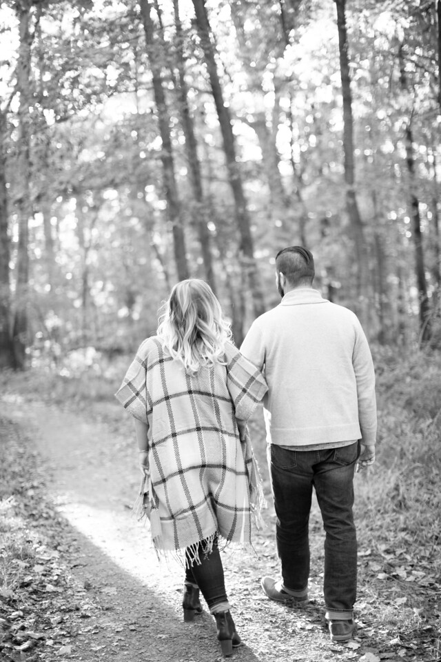 Black and white image of couple at their field engagement session in Virginia.