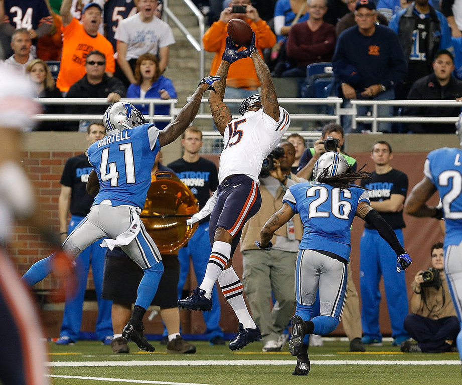 . Brandon Marshall #15 of the Chicago Bears tries to pull in a third quarter pass between Ron Bartell #41 and Louis Delmas #26 of the Detroit Lions at Ford Field on December 30, 2012 in Detroit, Michigan. Chicago won the game 26-24. (Photo by Gregory Shamus/Getty Images)