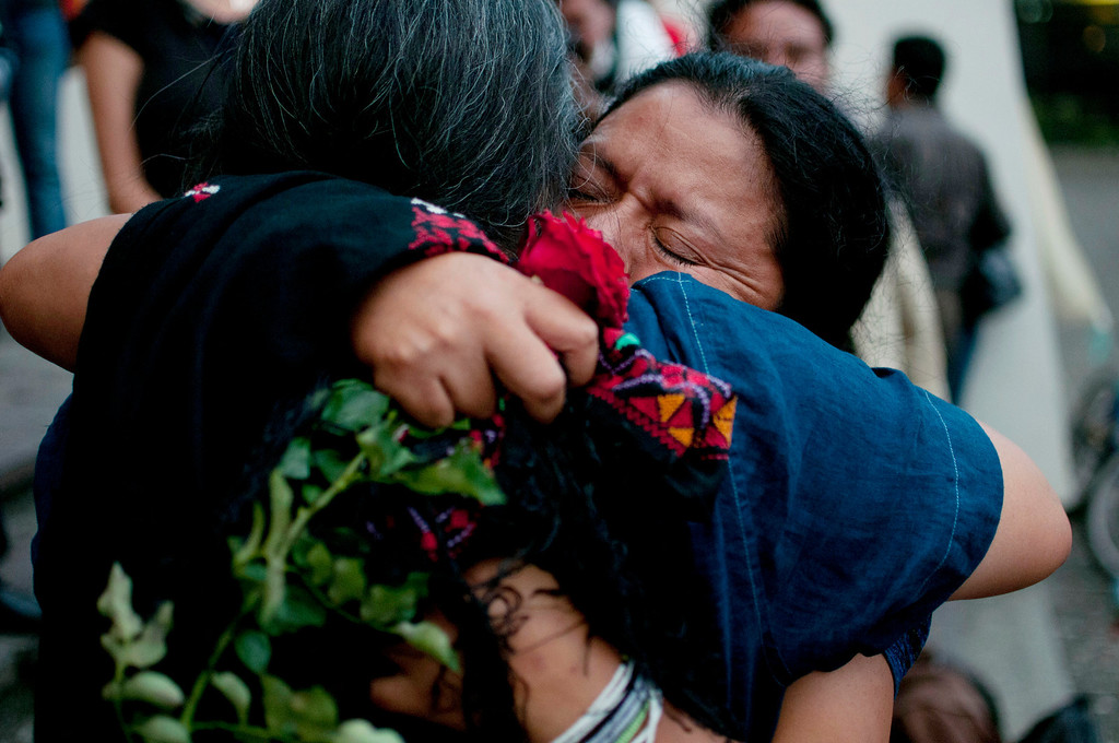 . The relatives of people who were killed in the country\'s civil embrace after the judge\'s guilty verdict for Guatemala\'s former dictator Jose Efrain Rios Montt after his trial for genocide in Guatemala City, Friday, May 10, 2013. The Guatemalan court convicted Rios Montt on charges of genocide and crimes against humanity, sentencing him to 80 years in prison. The 86-year-old former general is the first former Latin American leader ever found guilty of such a charge. The war between the government and leftist rebels cost more than 200,000 lives and ended in peace accords in 1996. (AP Photo/Luis Soto)