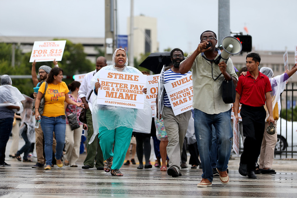 . People join in a fast food workers protest on May 15, 2014 in Miami, Florida.  (Photo by Joe Raedle/Getty Images)