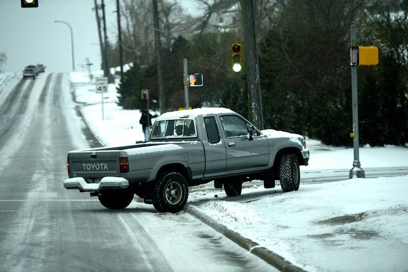 . A driver recovers from doing a 180 on an icy Sheridan Blvd in Arvada this morning, April 09, 2013 Arvada, Colorado. (Photo By Joe Amon/The Denver Post)