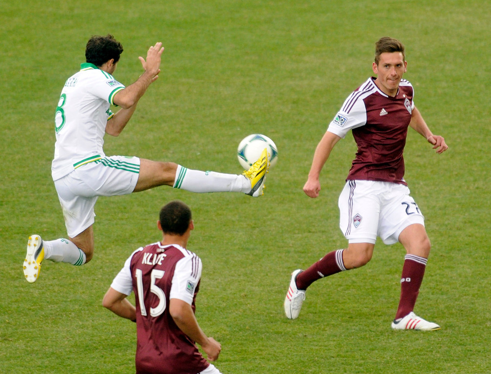 . Diego Valeri (8) of the Portland Timbers tried to deflect a pass from Rapids\' defender Shane O\'Neill (27) in the second half. The Colorado Rapids tied the Portland Timbers 2-2 Saturday, March 30, 2013 at Dick\'s Sporting Goods Park in Commerce City.  Photo By Karl Gehring/The Denver Post)