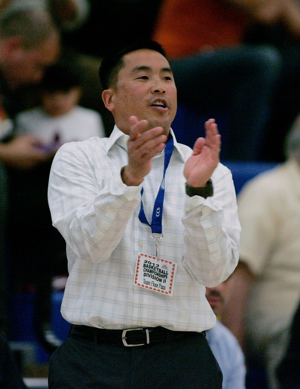 . Presentation coach Wade Nakamura cheers on his team in the third quarter during the CCS Division II girls basketball finals at Santa Clara High School in Santa Clara, Calif. on Friday, March 1, 2013. The Presentation Panthers beat the Woodside Wildcats, 49-34. (Jim Gensheimer/Staff)