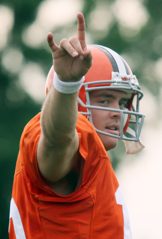 . News-Herald file Browns rookie quarterback Colt McCoy gives the Longhorn sign to as he greets fans on the sideline calling his name at the start of Saturday\'s morning workout in Berea.