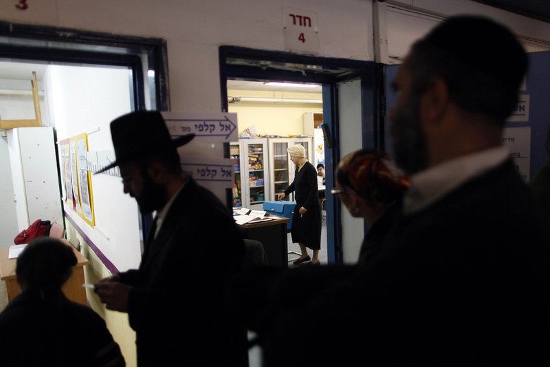 . An Ultra Orthodox Jewish woman casts her ballot at a polling station on election day on January 22, 2013 in Jerusalem, Israel. Israel\'s general election voting has begun today as polls show Netanyahu is expected to return to office with a narrow majority. (Photo by Lior Mizrahi/Getty Images)