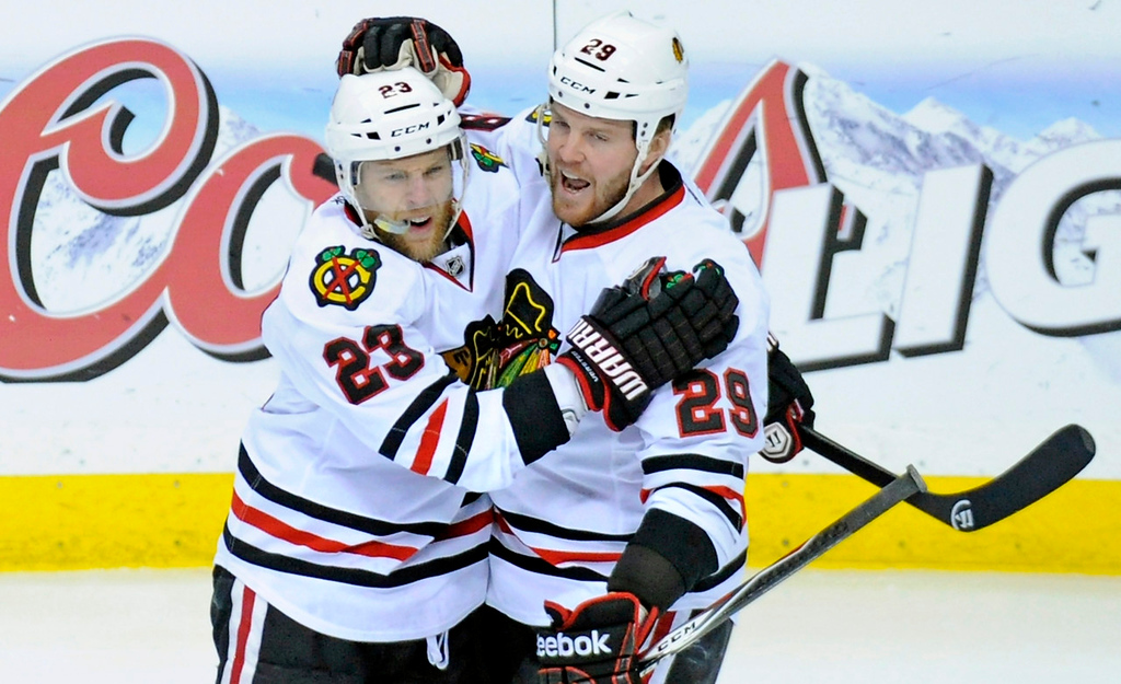 . Chicago\'s Kris Versteeg, left, celebrates his first period goal with teammate Bryan Bickell against the Wild. (Photo by Hannah Foslien/Getty Images)