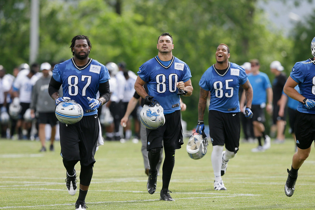 . Detroit Lions tight ends Brandon Pettigrew (87) Joseph Fauria (80) and Eric Ebron (85) run off the field after an NFL football minicamp in Allen Park, Mich., Wednesday, June 11, 2014. (AP Photo/Carlos Osorio)