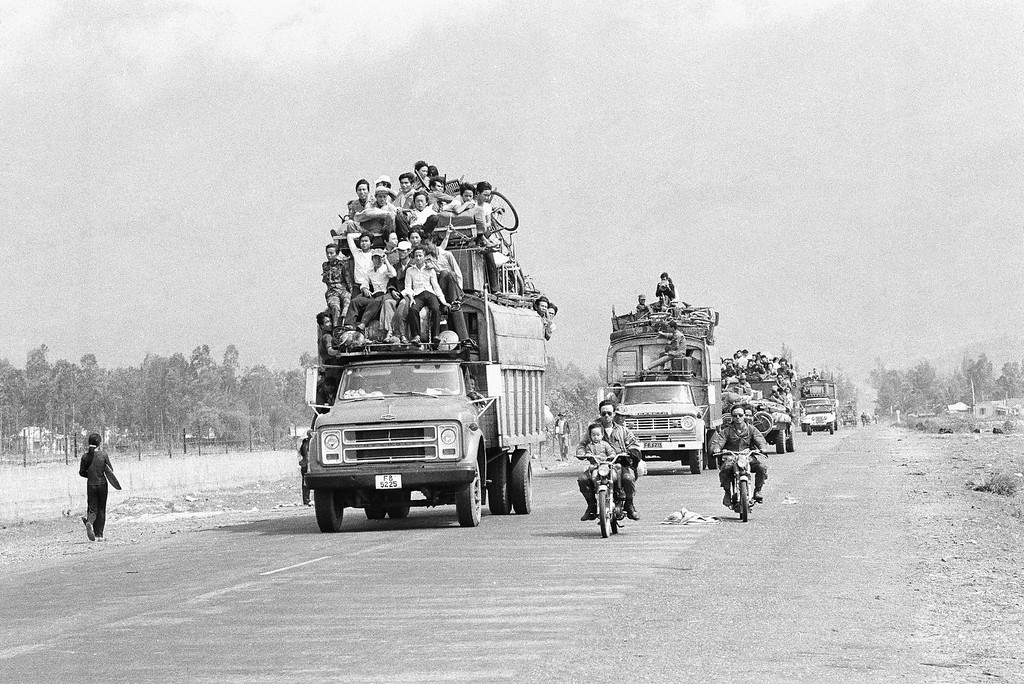 . Trucks and motorbikes, loaded with refugees, roar along the main highway from the old imperial capital of Hue to the port city of Danang about 50 miles south of Hue, March 25, 1975. Hue?s 200,000 inhabitants have been streaming southward since the Saigon government?s decision to abandon the city in the face of a heavy North Vietnamese buildup. (AP Photo)