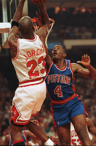 Description of . ** FILE ** Detroit Pistons Joe Dumars (4) defends Chicago Bulls' Michael Jordan during game 1 of the NBA Eastern Conference finals in this May 22, 1991 photo, in Chicago. The Detroit Pistons, who devised a scheme called the