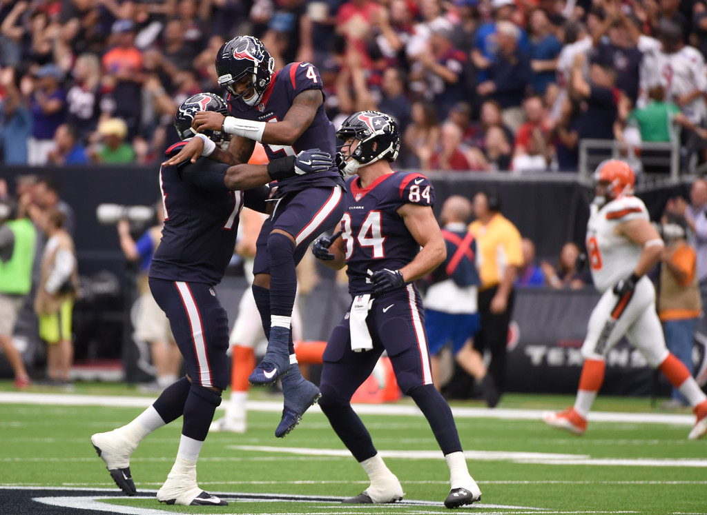 . Houston Texans\' Chris Clark, left, Deshaun Watson (4) and Ryan Griffin (84) celebrate a touchdown scored by wide receiver Will Fuller V in the first half of an NFL football game against the Cleveland Browns, Sunday, Oct. 15, 2017, in Houston. (AP Photo/Eric Christian Smith)